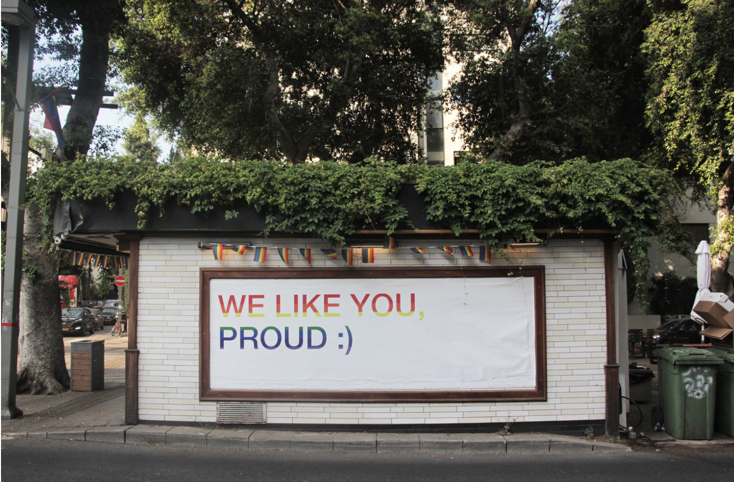 """sign on side of road that says """"we like you proud :)"""""""